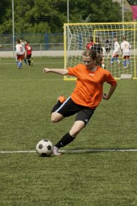 teen playing soccer