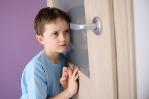 frightened child listening at door